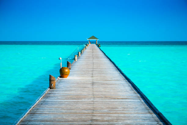 Jetty at Dhiffushi Holiday island, South Ari atoll, Maldives stock photo