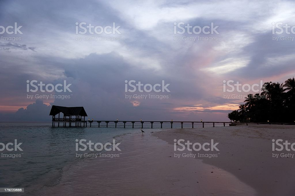 jetty at red sunset stock photo