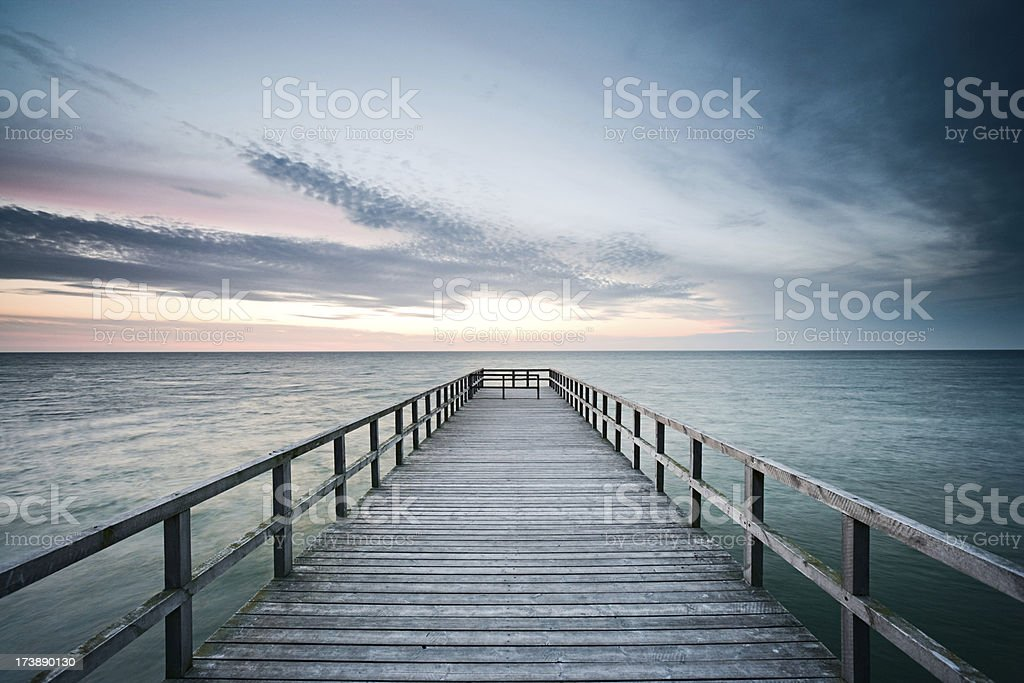 Jetty at sunset stock photo