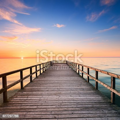 Sunset ovet the sea - pier, sea, storm clouds. http://bhphoto.pl/IS/sand_dunes_380.jpg