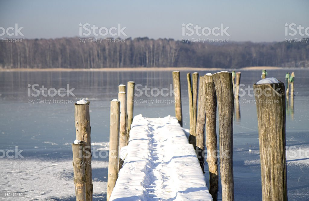 Jetty covered with snow stock photo
