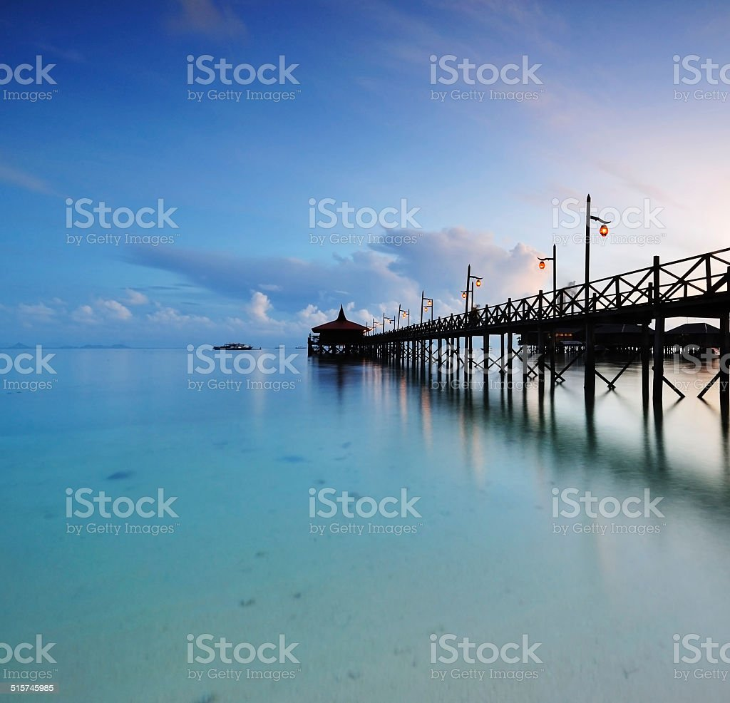 Jetty in Mabul Island at sunrise, long exposure stock photo
