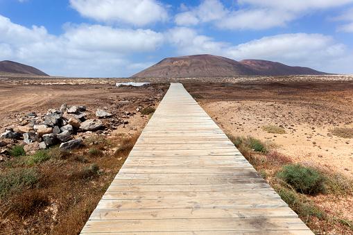 Jetty in volcanic landscape on the island La Graciosa
