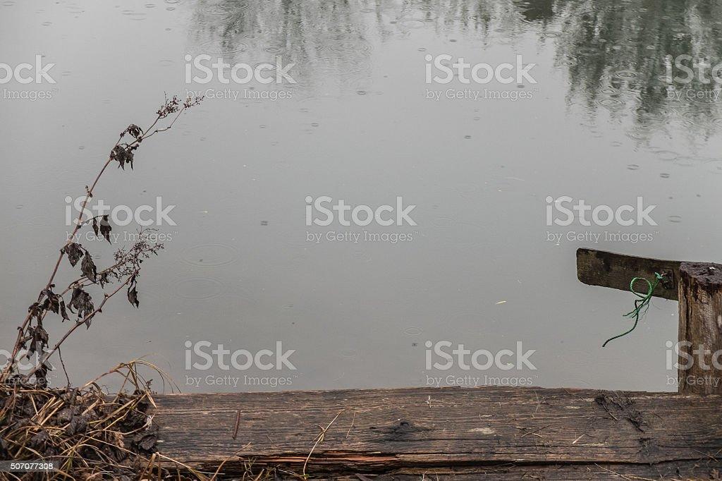 Jetty in winter rain stock photo
