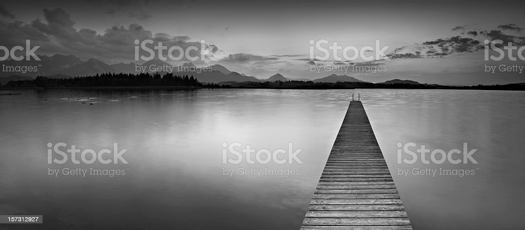 Jetty into a Mountain Lake stock photo