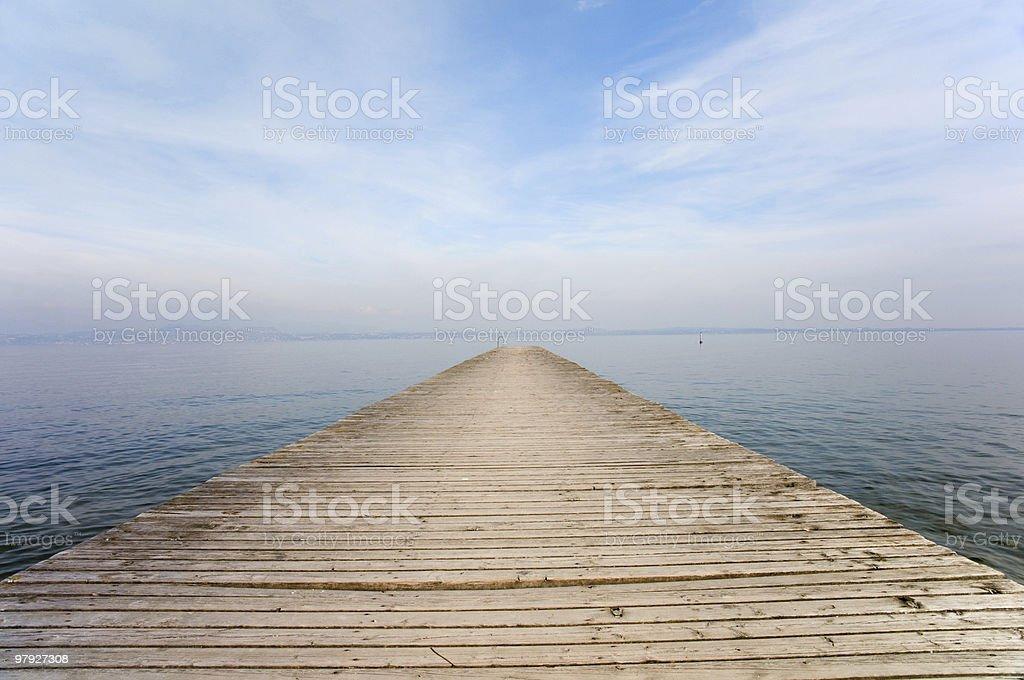 Jetty into Garda Lake royalty-free stock photo