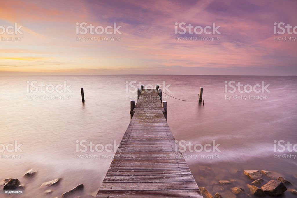 Jetty on a lake at sunrise, Markermeer, The Netherlands royalty-free stock photo