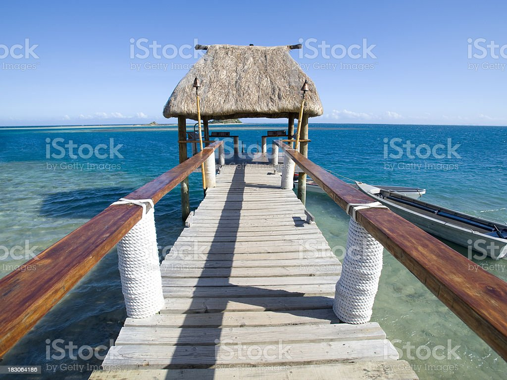 Jetty on a tropical island royalty-free stock photo