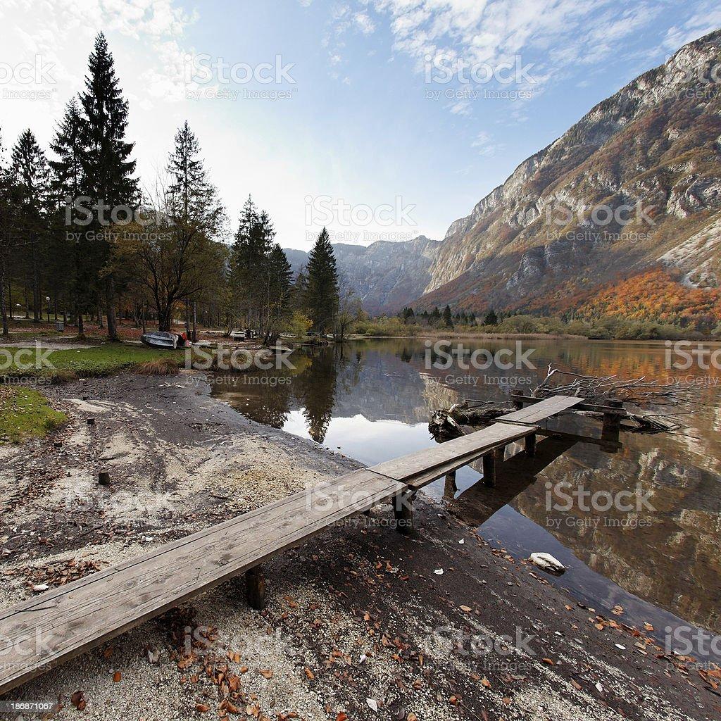 jetty on the mountain lake royalty-free stock photo
