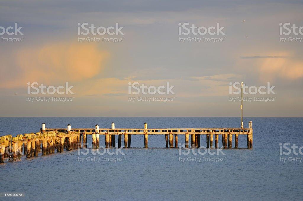 Jetty Over Ocean, Morning Light royalty-free stock photo
