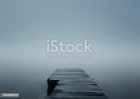 Wooden jetty over frozen lake