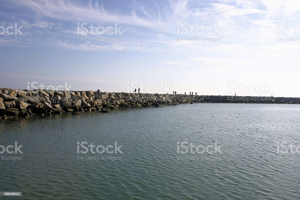Jetty with people fishing royalty-free stock photo