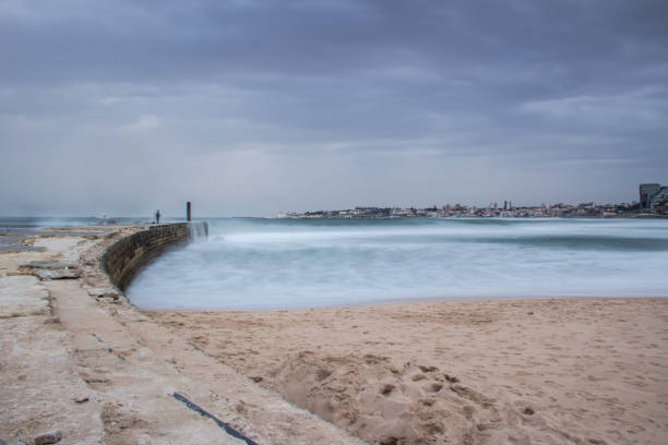 jetty with storm dramatic clouds in background. - rain clouds porto portugal imagens e fotografias de stock