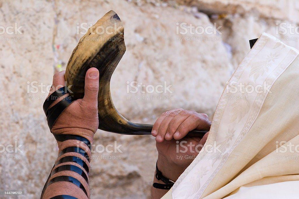 Jew blowing in shofar of Rosh hashana. stock photo