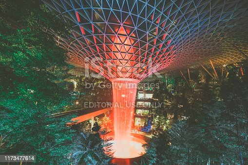 Jewel Changi Airport, Singapore - July 30th 2019 : Jewel Changi Airport Rain Vortex. The largest indoor waterfall in the world . View of the Rain Vortex at night.
