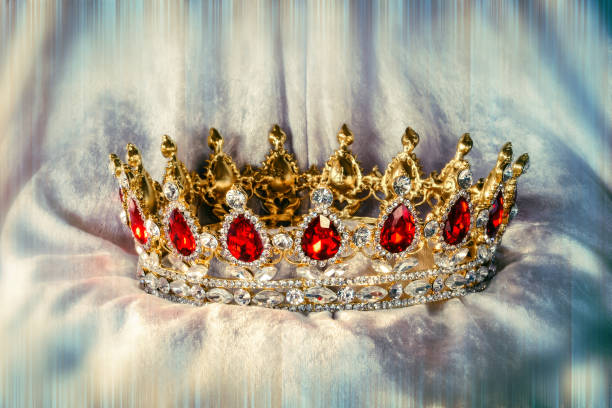 jewel crown on soft cloth - crown stock photos and pictures