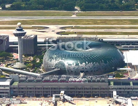 Singapore, Singapore - January 25, 2020: Aerial view of the control tower at Changi Airport and Jewel, a shopping mall.