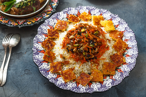 istock Jeweled rice or shirin polo in traditional plate 932448388