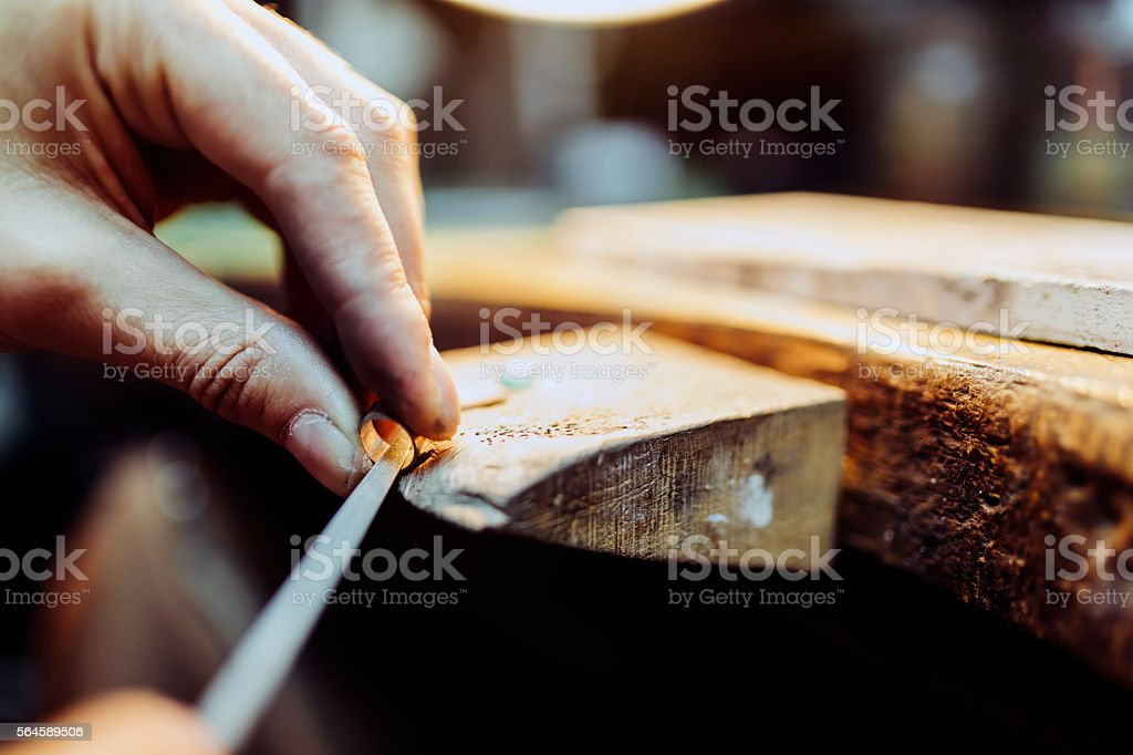 Jeweler crafting jewelry stock photo