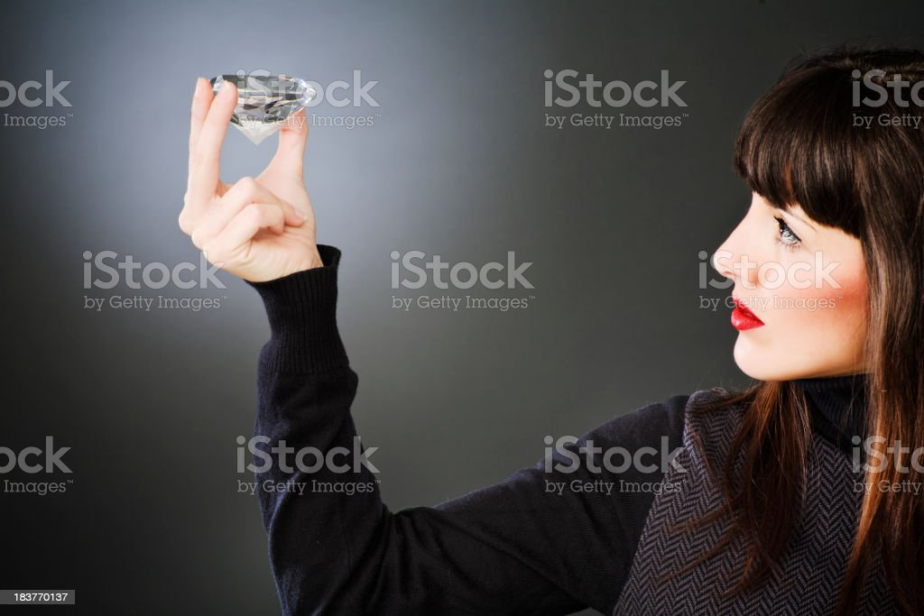 Jeweler inspecting a huge diamond _ horizontal royalty-free stock photo
