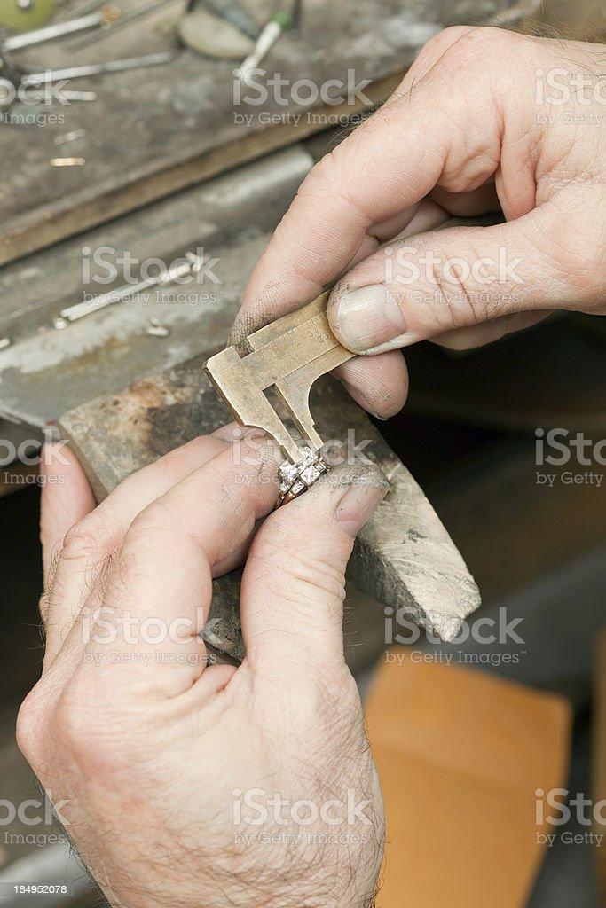 Jeweler Using Caliper to Measure Diamond Wedding Ring stock photo