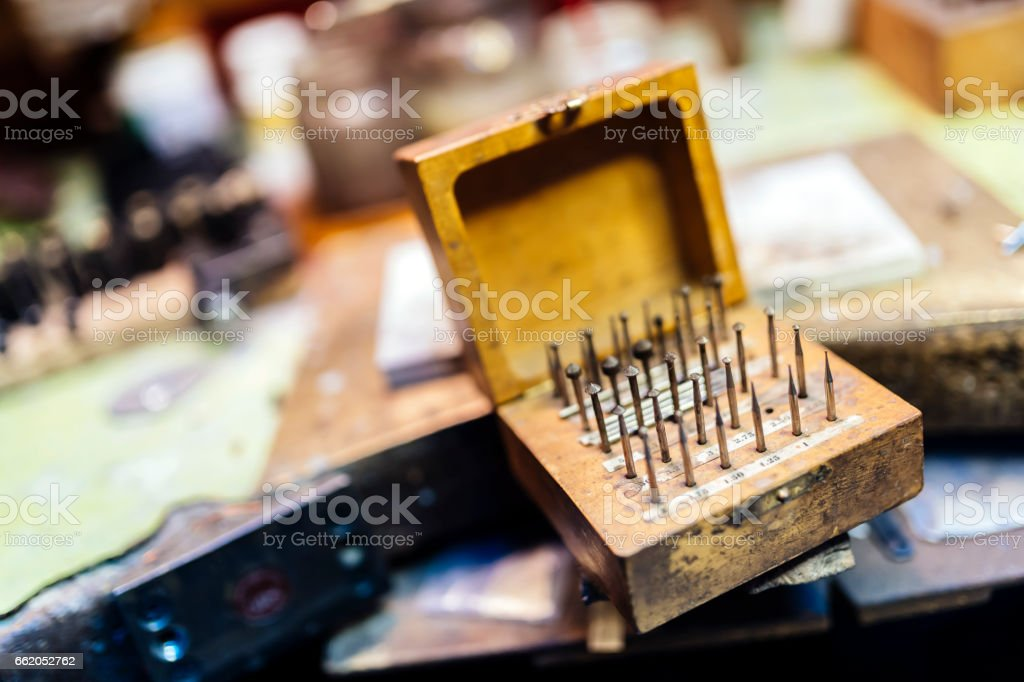 Jewelers' tools placed on workbench royalty-free stock photo