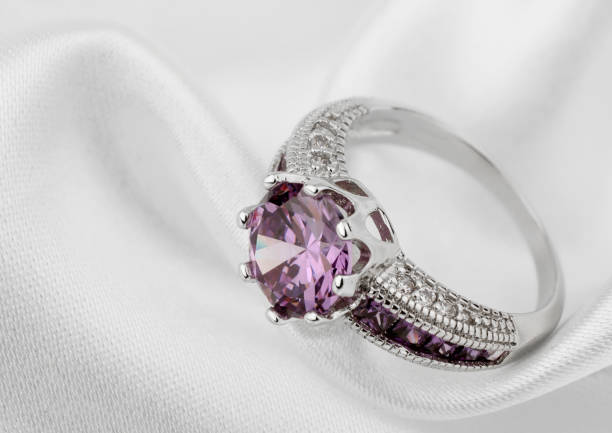 jewelery ring on white cloth background - ring jewelry stock photos and pictures