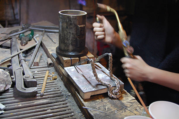 jeweller making silver chain goldsmith worplace, hands and tools soldering iron stock pictures, royalty-free photos & images