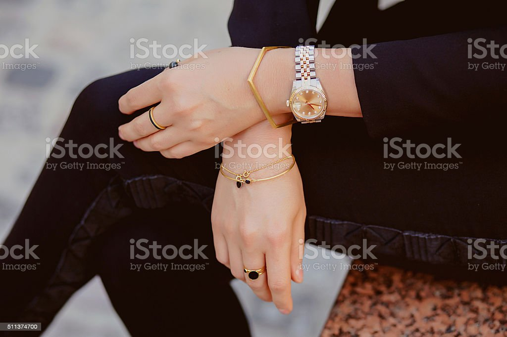 Jewellery closeup on female hands stock photo