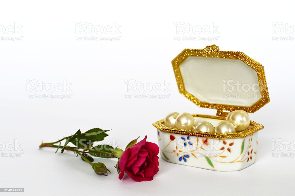 Jewelry box and rose on light background stock photo