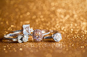 Jewelry diamond ring with abstract festive glitter Christmas holiday texture background blur with bokeh light