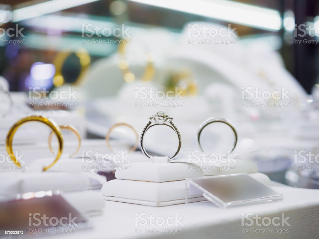 Jewelry diamond rings and necklaces show in luxury retail store window display stock photo