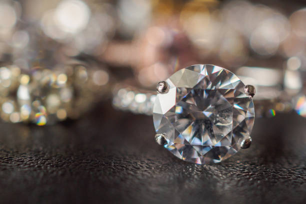 jewelry diamond rings set on black background close up - jewelry stock photos and pictures
