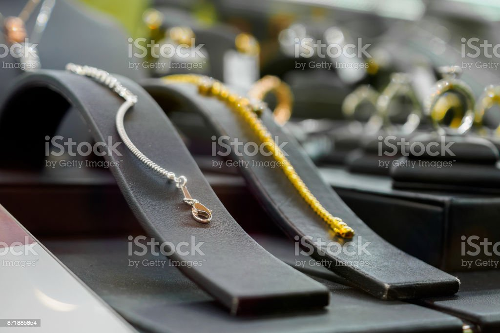 jewelry diamond shop with bracelet rings and necklaces in luxury retail store stock photo