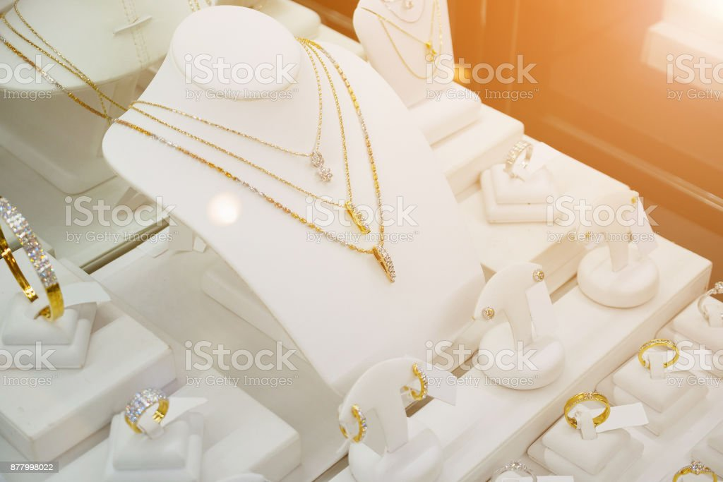 Jewelry diamond shop with rings and necklaces luxury retail store window display stock photo