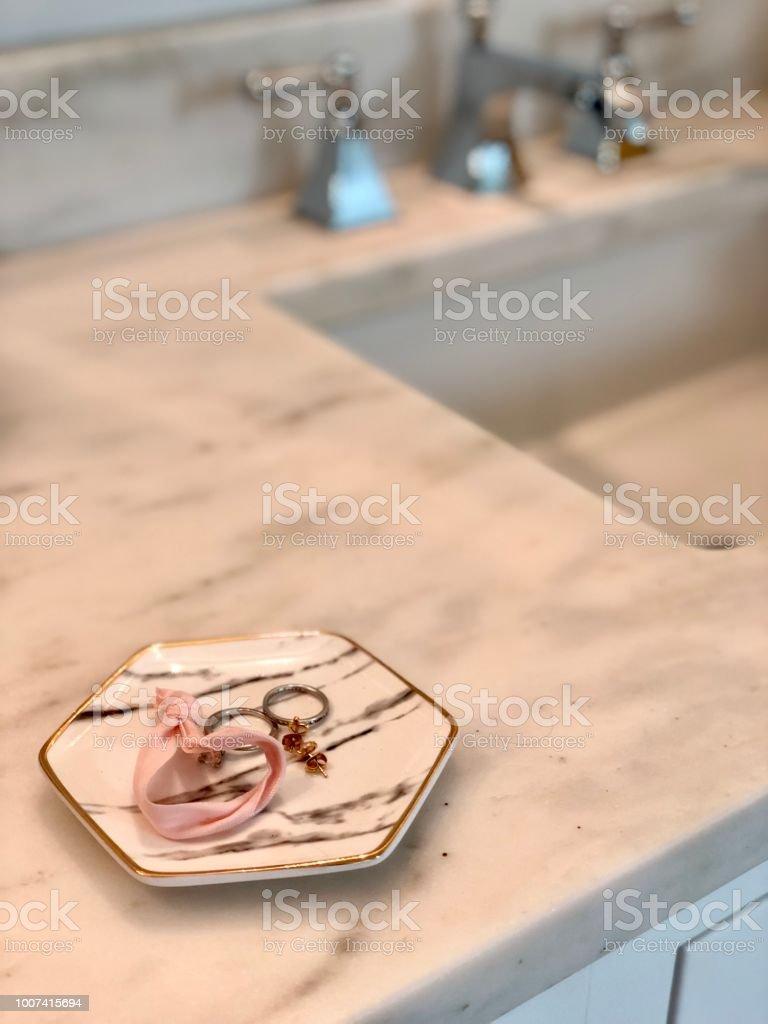 Jewelry dish next to sink stock photo