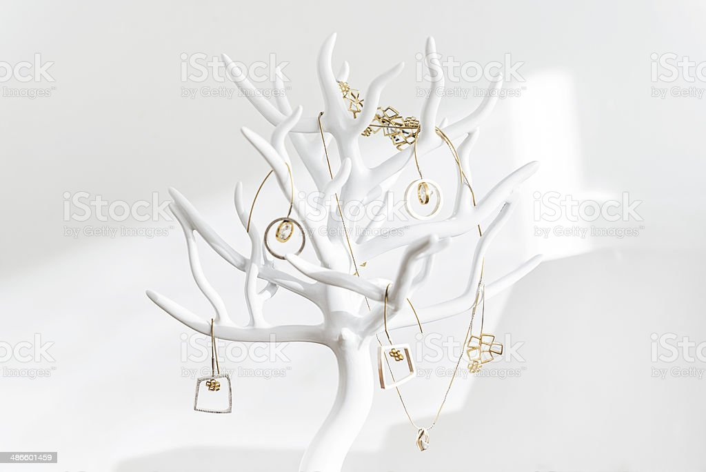 Jewelry display, stand hanger in shape of tree in white stock photo