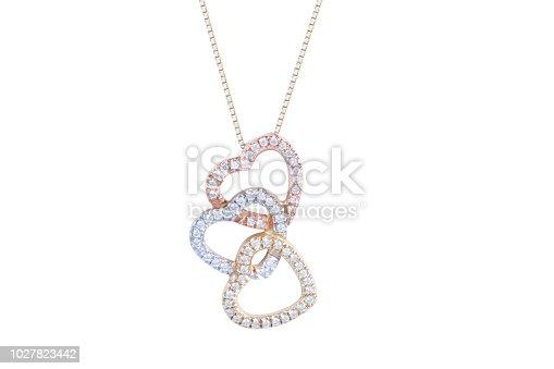 Beautiful jewelry gold heart-shaped necklace with white gemstone diamonds on white background. Isolated.