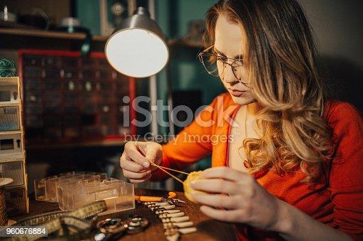 512345816istockphoto Jewelry maker working in the workshop 960676884