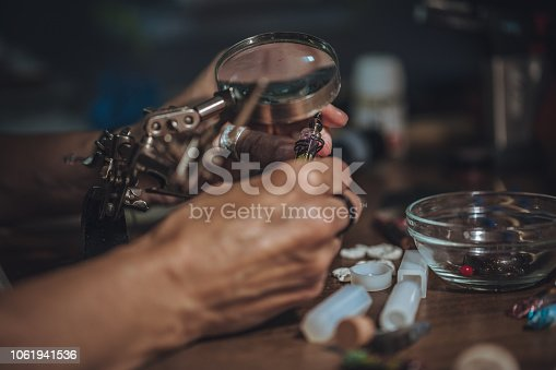 991427116 istock photo Jewelry making in workshop 1061941536
