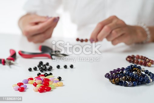 1074436306istockphoto Jewelry making. Production bracelets and necklaces from multi-colored beads. 1133605104