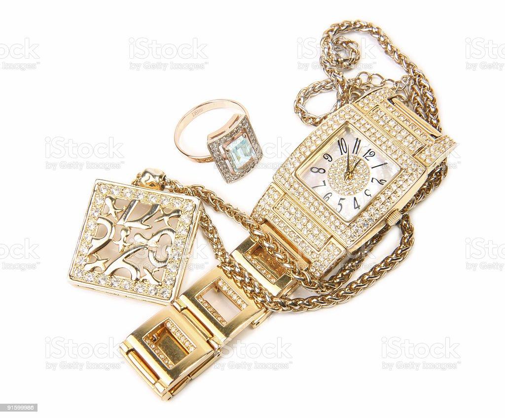1fc40a3130114 Conjunto de anel de ouro, joias, relógios e brincos foto royalty-free