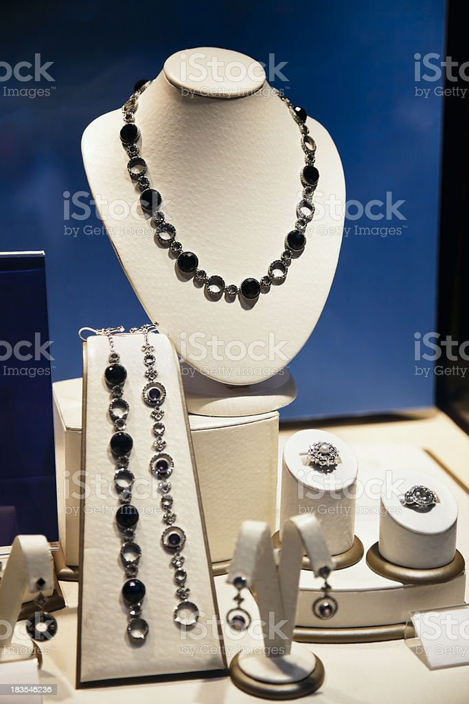 Jewelry Store Display Case with Necklaces, Earrings, and Rings royalty-free stock photo