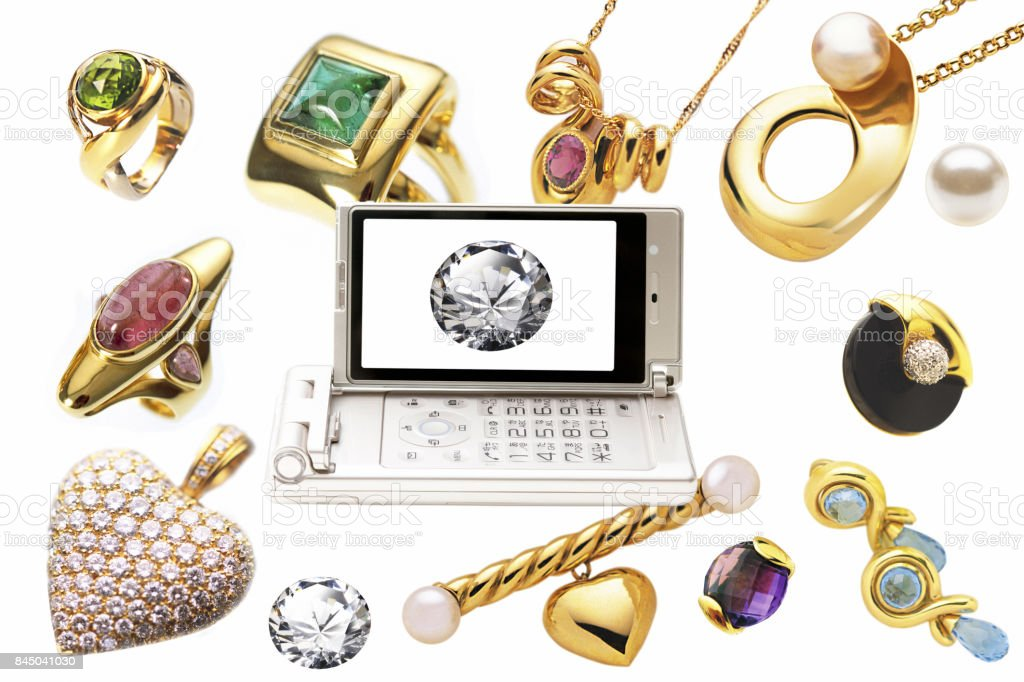 Jewelry with diamonds on the mobile screen stock photo