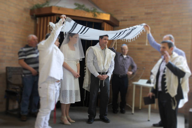 Jewish bride and a bridegroom wedding Ceremony Jewish bride and a bridegroom married in a modern Orthodox Jewish wedding ceremony in a synagog. judaism stock pictures, royalty-free photos & images