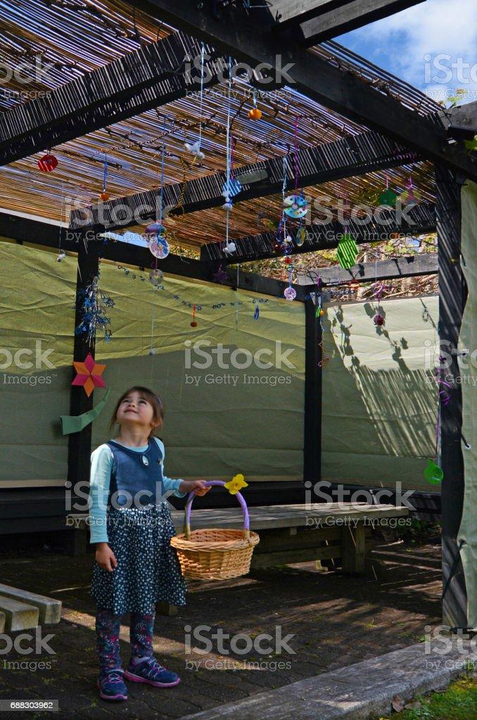 Jewish child decorating the family Sukkah stock photo