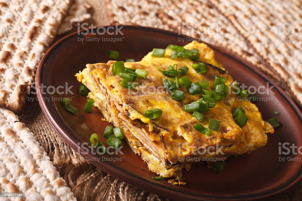Jewish cuisine: matzah brei with green onions close-up. horizontal stock photo