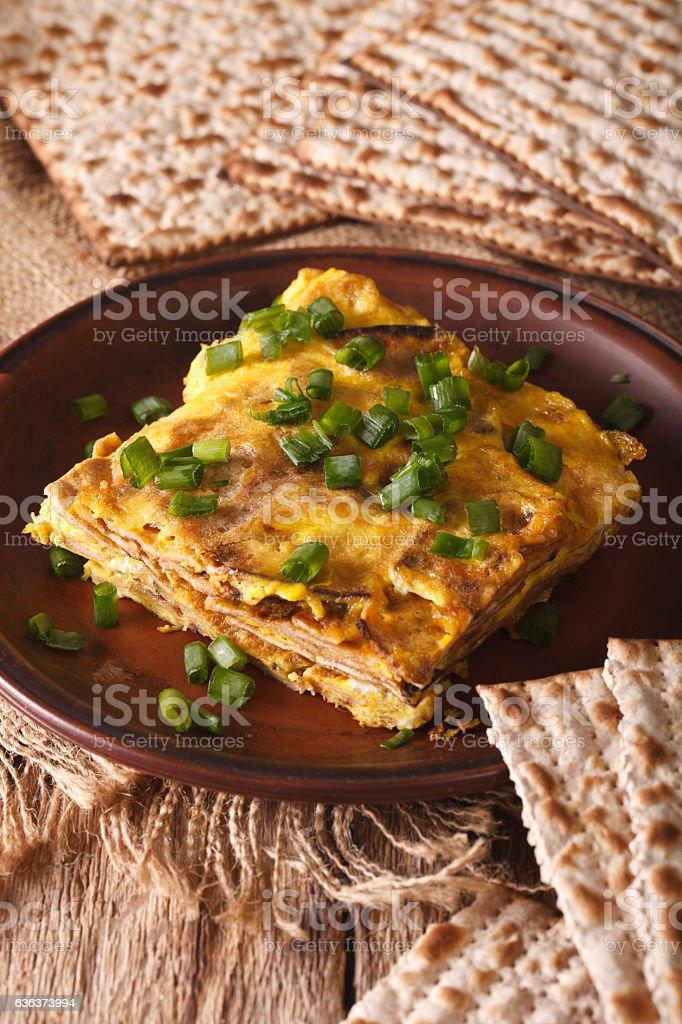 Jewish cuisine: matzah brei with green onions close-up. Vertical stock photo