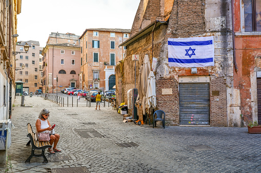 Rome, Italy, July 15 -- A Jewish Culture Center along Portico d'Ottavia street, in the ancient Jewish Ghetto, in the historic heart of the Eternal City. The iconic Jewish Quarter of Rome, the oldest ghetto in Europe, is famous for the presence of hidden alleys and small squares, where it is easy to find small restaurants of Italian and Jewish cuisine, and remarkable Roman archaeological remains. The ghetto of Rome is located in one of the oldest districts of the city between the Campidoglio (Roman Capitol Hill) and the River Tiber. In 1980 the historic center of Rome was declared a World Heritage Site by Unesco. Image in high definition format.