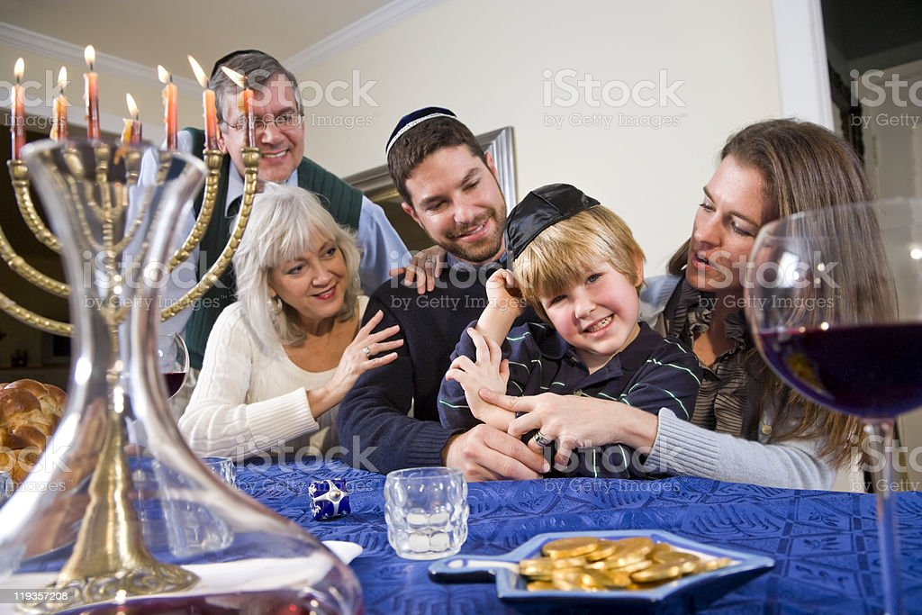 Jewish family celebrating Chanukah stock photo